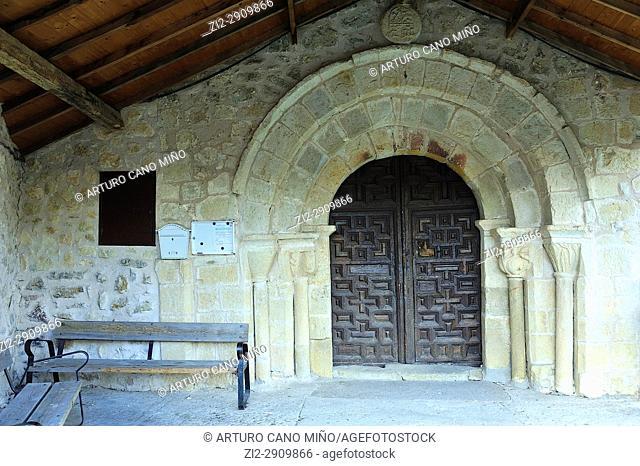 The Romanesque gateway of the parish church of Saint Peter the Apostle. Poveda de la Sierra town, Guadalajara province, Spain