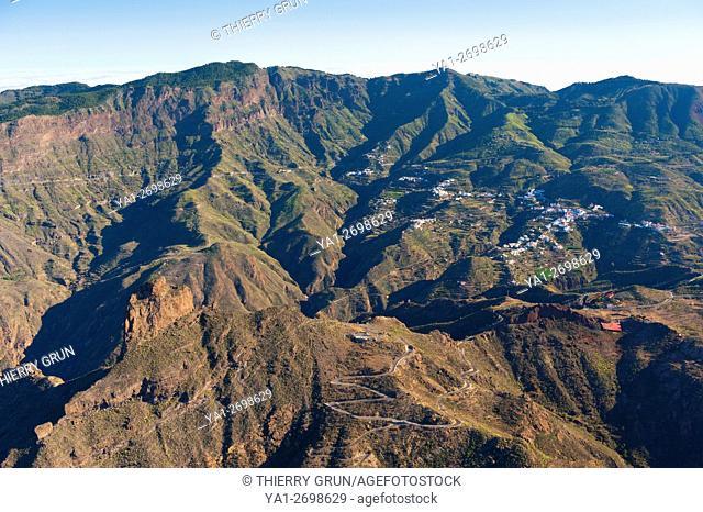 Spain, Canary islands, Gran Canaria, Tejeda, valley, village and Roque Bentayga (aerial view)