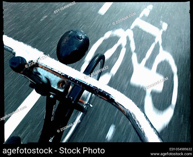 bicycle sign steer movement street dark rain amsterdam netherlands
