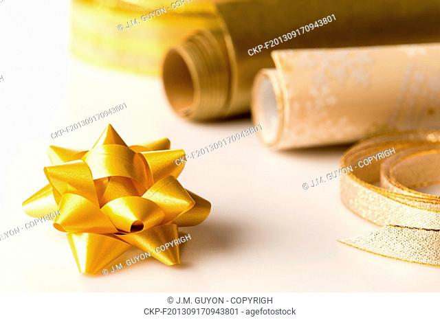 Golden wrapping paper and bow for christmas present decoration