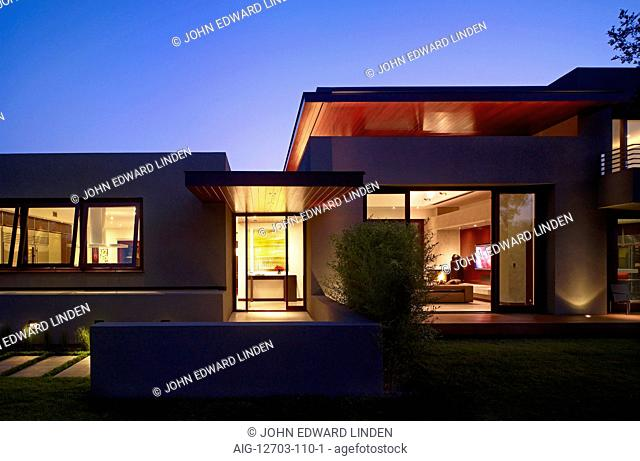 Exterior dusk shot of a modern one storey house, California