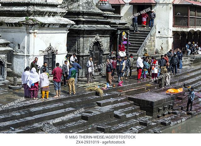 Cremation ghat along the Bagmati river, Pashupatinath Temple complex, Unesco World Heritage Site, Kathmandu, Nepal