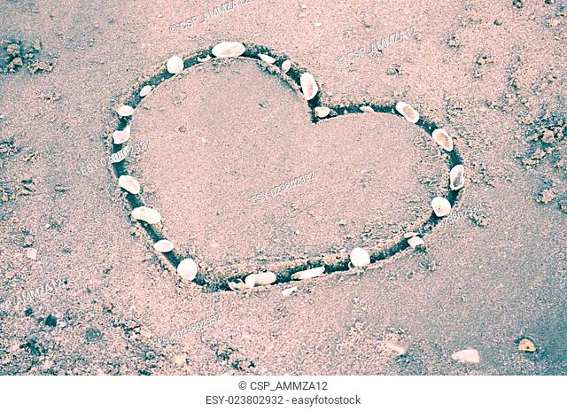 a heart on the sand in the beach