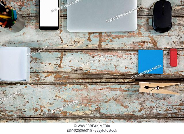 Laptop, smartphone and mouse with office accessories