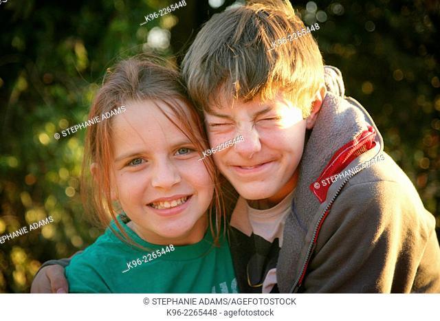 Happy siblings on camping trip