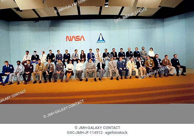 The 35 new astronaut candidates, presented Jan. 31, 1978, in the Building 2 auditorium at NASA's Johnson Space Center, pose for photographers