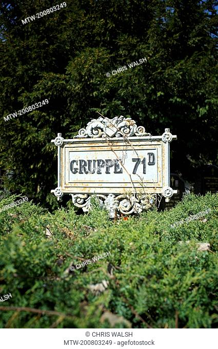 Sign cemetery group area row metal guidepost