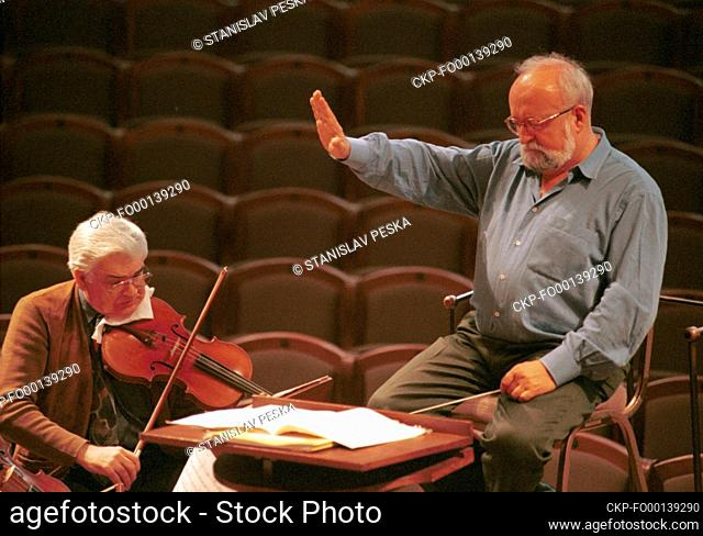 ***FILE PHOTO*** Krzysztof Penderecki, right, Polish composer and conductor, is seen during a rehearsal with the Czech Philharmonic Orchestra in Rudolfinum