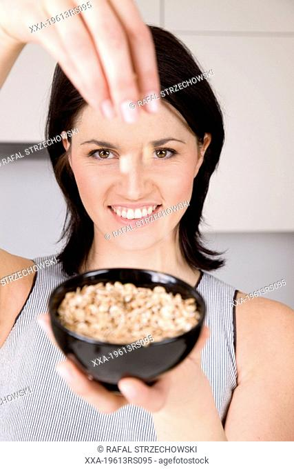 Woman with bowl of oats