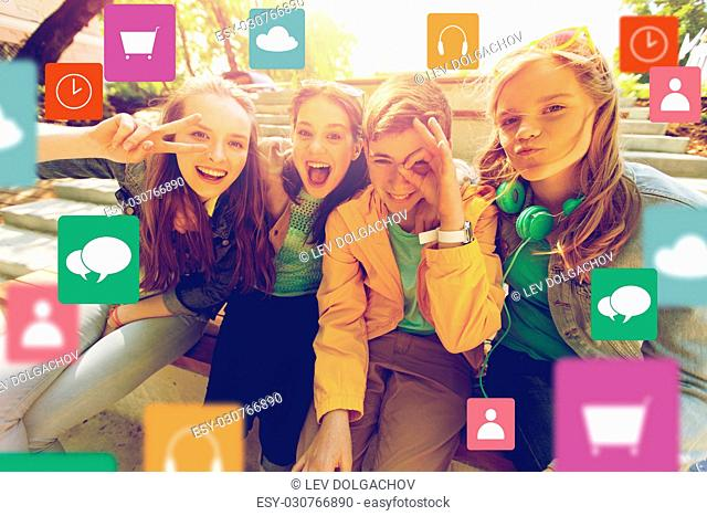technology, friendship and people concept - happy teenage friends or high school students having fun and making faces with menu icon