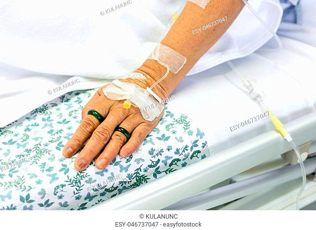 Tube of saline solution stick on patient hand to treatment