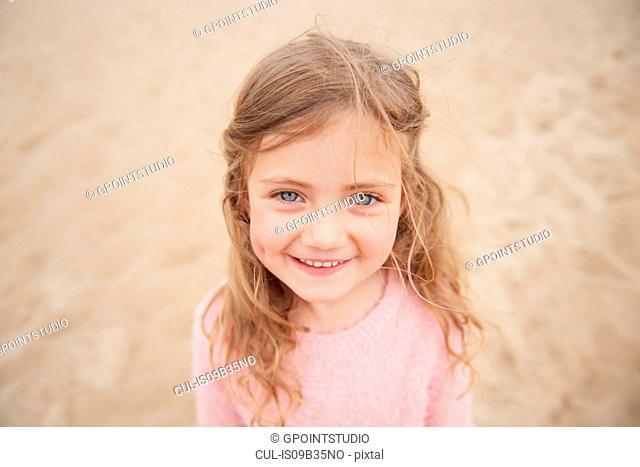 Little girl smiling on beach