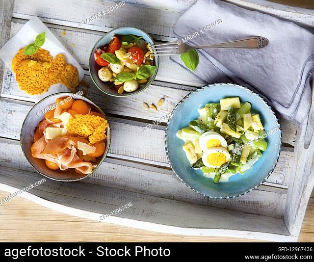 Asparagus salad variations and melon with parmesan ham