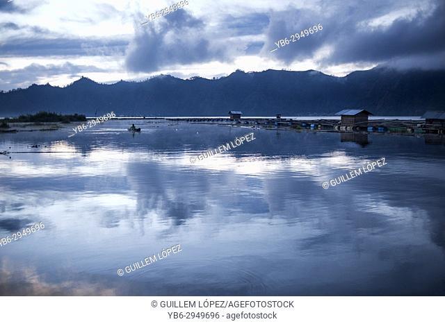 A fisherman in his boat at the Lake Buyan, Bali, Indonesia