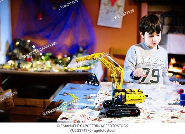 Child builds bulldozer lego