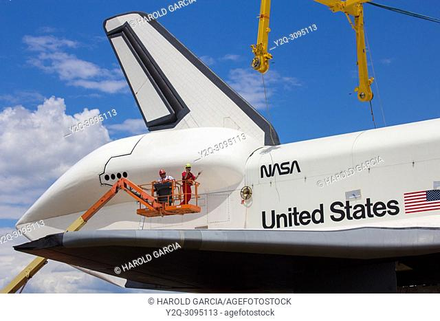 Side view of The Space Shuttle Enterprise on the Hudson River by midtown Manhattan taken to the Aircraft Carrier Intrepid where it will be placed by crane