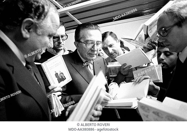 Giulio Andreotti during the 7th National Friendship Day. Minister of Foreign Affairs of the Italian Republic Giulio Andreotti signing autographs on his books...
