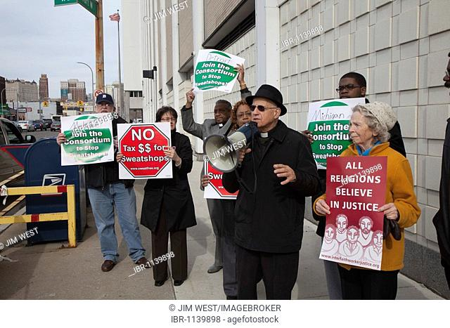 Religious groups rally at the Detroit post office as taxpayers mail their last-minute tax returns to urge that governments stop spending tax dollars to buy...