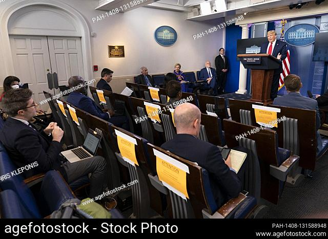 United States President Donald J. Trump participates in a news briefing with members of the Coronavirus Task Force at the White House in Washington