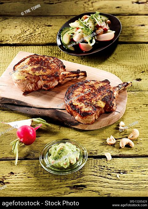 Iberico pork chops with radish and cucumber salad