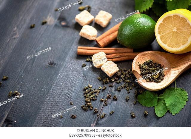 tea composition with cinnamon sticks, lemons