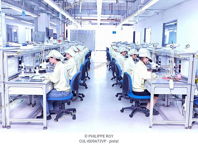 Quality check station at factory producing flexible electronic circuit boards. Plant is located in the south of China, in Zhuhai, Guangdong province