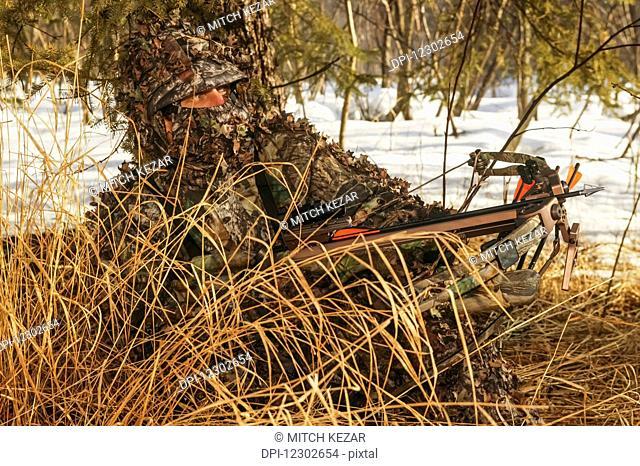 Crossbow Hunter Hunting Whitetail Deer