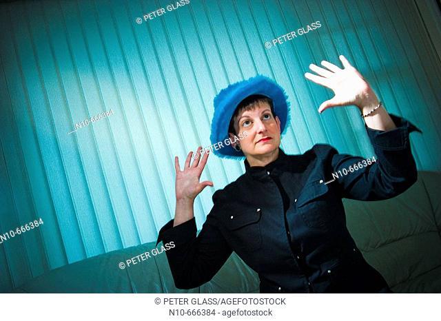 Woman posing in a blue hat