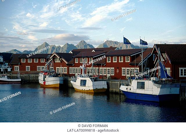 Fishing village. Houses,warehouses. Fishing boats moored. Arctic Circle
