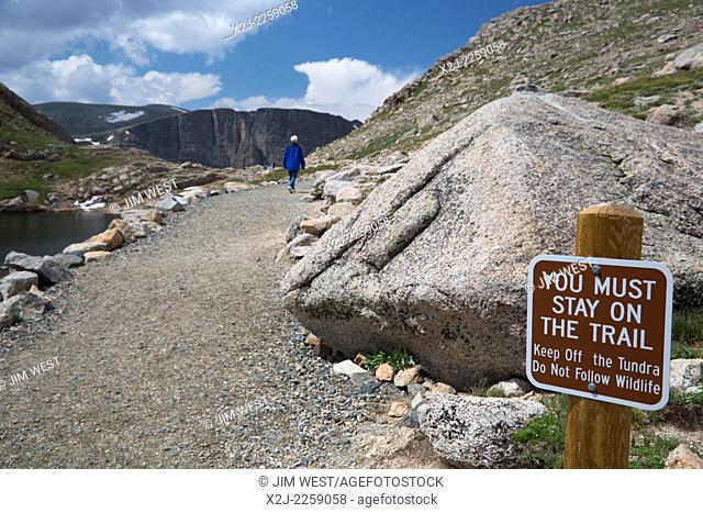 Idaho Springs, Colorado - A hiker on a trail near Summit Lake on Mt. Evans. Mt. Evans is one of the most accessible high peaks in the American west