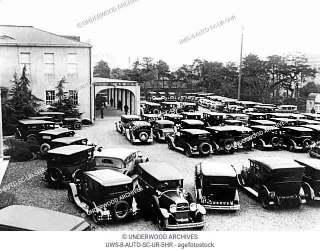 Tokyo, Japan: c. 1928 American cars in the parking lot used by the representatives of the Imperial Diet as it opened its session today