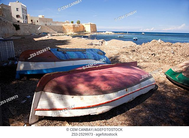 Colorful fishing boats at the beach near the old town with the Torre di Ligny Museo Marinaro at the background, Trapani, Sicily, Italy, Europe