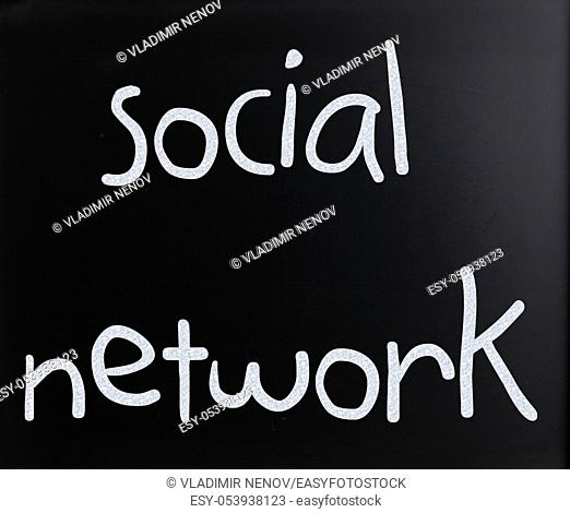 "The word """"Social network"""" handwritten with white chalk on a blackboard"
