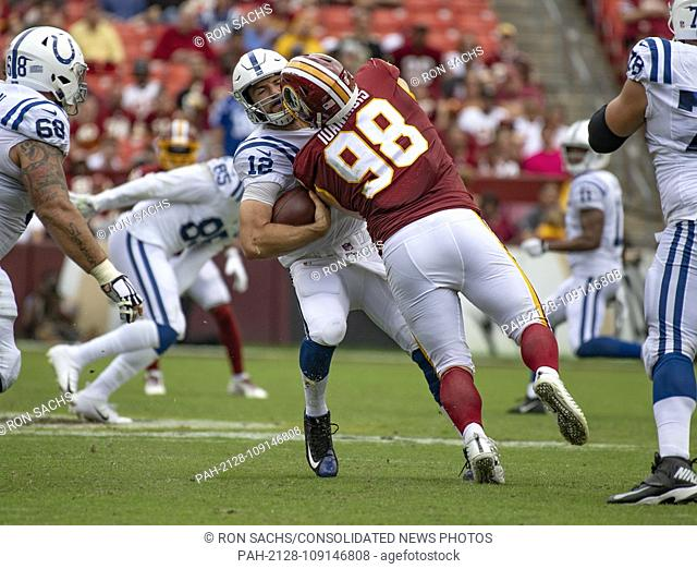 Indianapolis Colts quarterback Andrew Luck (12) is sacked by Washington Redskins defensive tackle Matthew Ioannidis (98) in the second quarter at FedEx Field in...