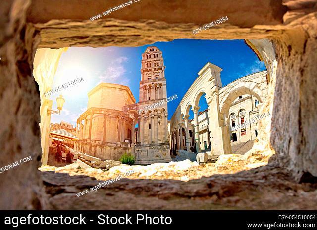 Ancien old Roman queen Jelena square and cathedral in Split view through stone window, Dalmatia, Croatia