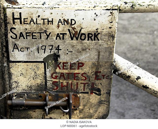 England, North Yorkshire, Grosmont, Detail of a health and safety at work sign at Grosmont railway station