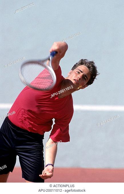 Man serving in tennis match