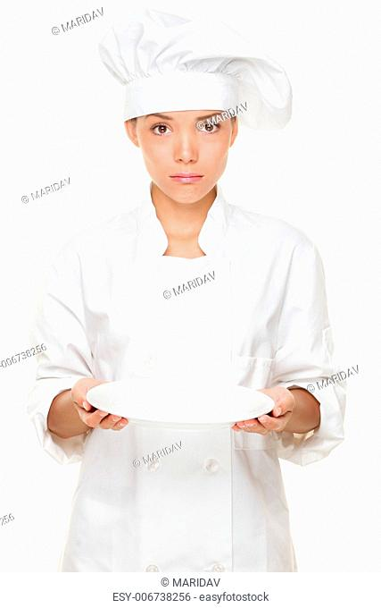 Chef disappointed and sad with empty plate. Woman chef serving empty plate looking negative and funny. Multicultural Asian Caucasian woman chef
