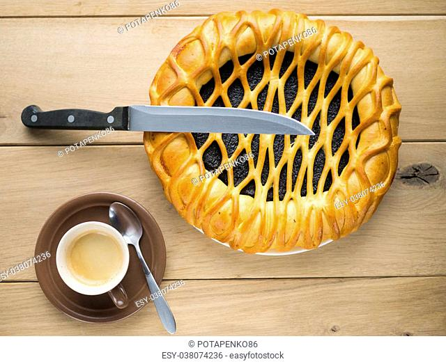 Image of poppy pie and coffee on wood background