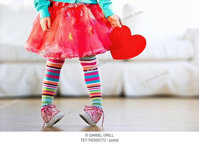Young girl wearing colorful tights