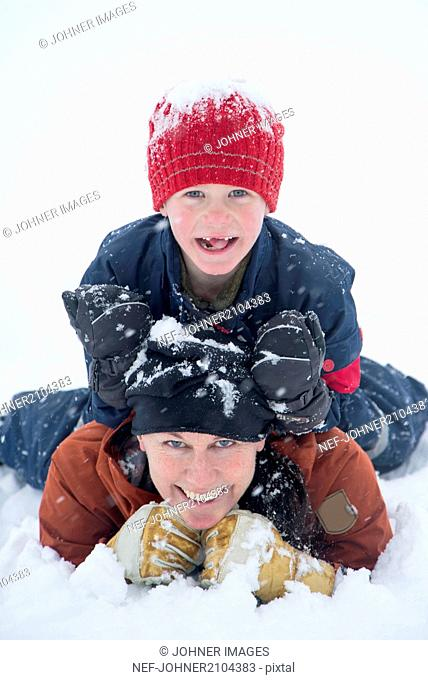 Mother with son on snow