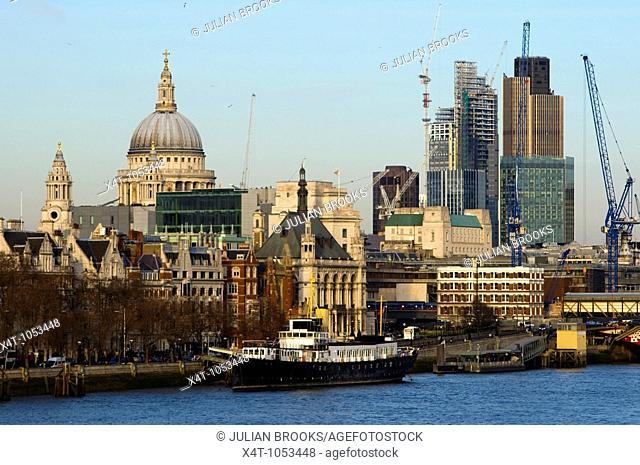 London Skyline from Waterloo bridge showing building work in progress and St Paul's Cathedral in late afternoon sunshine
