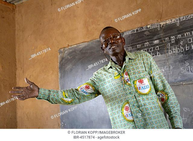 Teacher in front of blackboard, Toeghin village, Oubritenga province, Plateau Central region, Burkina Faso