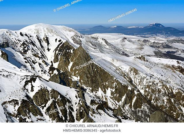 France, Puy de Dome, natural regional park of the volcanoes of Auvergne, Besse-en-Chandesse, Monts Dore mountain range and Puy de Dome volcano in the background