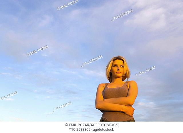 Watching sunset young woman against sky