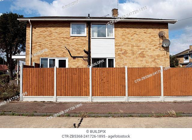 Wooden boundary fencing surrounding 1970's built housing, Benfleet, Essex, UK
