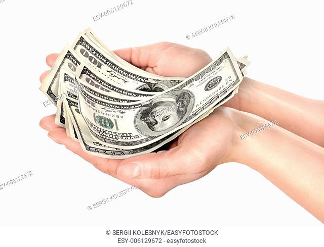 Hand holds hundreds of dollars isolated on white background