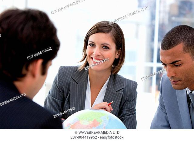 Fortu te business team looking at a terrestrial globe
