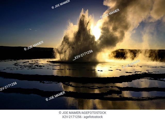Great Fountain Geyser erupting at sunset