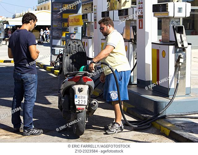 Motorcyclist filling up with pewtrol at Shell Petrol station Argostoli Cephalonia Greece